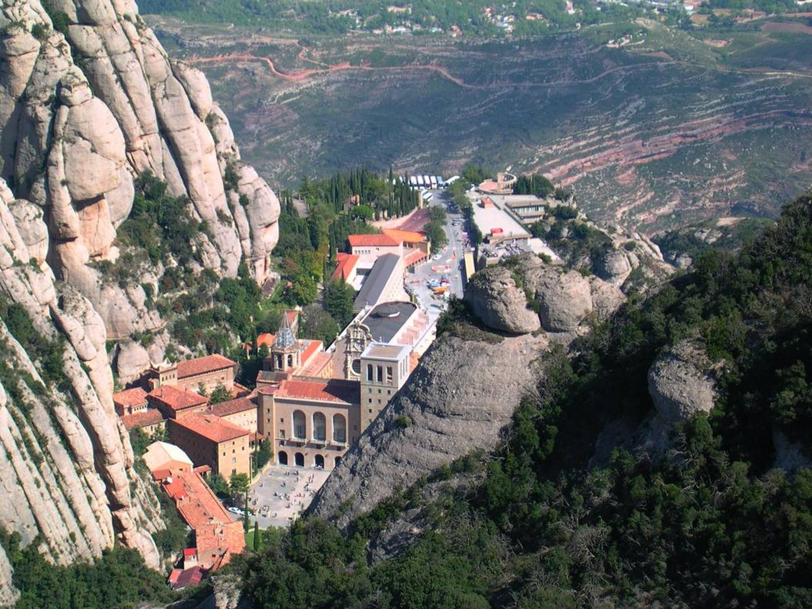 View from the top: the Abbey at Santa Maria de Montserrat. Yes, we'll be cycling up to the abbey. From way down there in the valley. And did we mention it's gravel? (Creative Commons license)