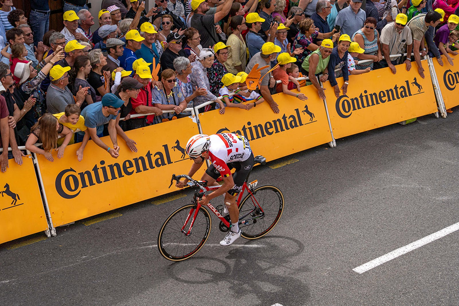 Thomas De Gendt's team mate Tiesj Benoot drills it for the finish