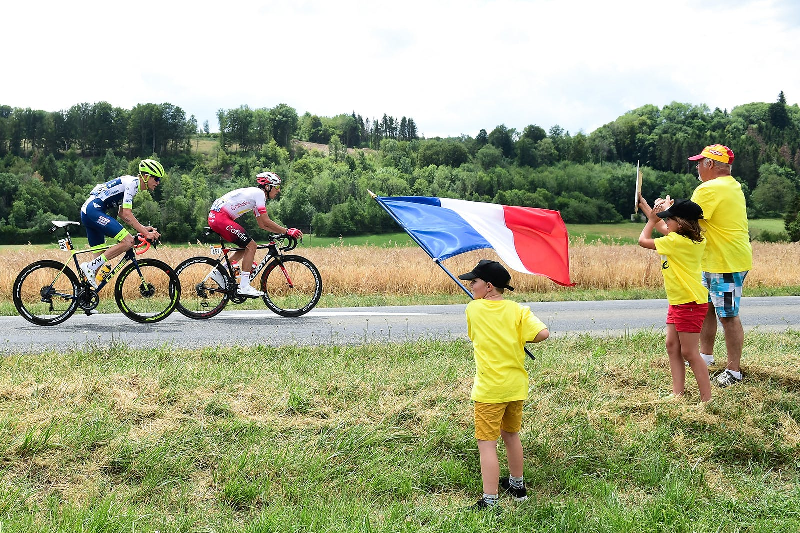 A young fan waves a French tricolour at the Tour de France